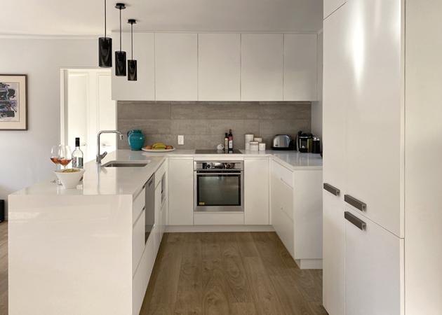 Waiheke Bach kitchen - white cabinetry